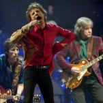 Mick Jagger, center, Ronnie Wood, left, and Mick Taylor, of the Rolling Stones  perform at Glastonbury, England, on Nov. 19, 2013.
