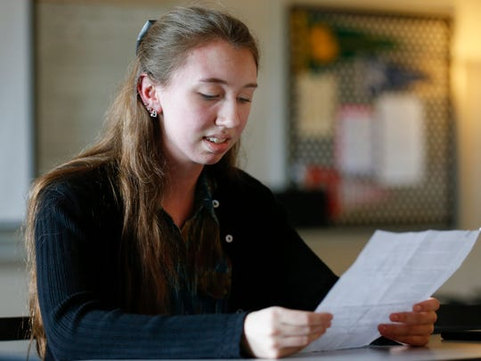 Willard High School senior Kira Ray reads her entry for the LAD Fair about anger.