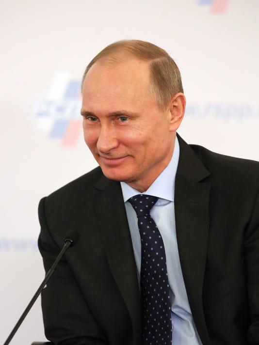 -NASBrd_03-22-2014_Tennessean_1_B003~~2014~03~21~IMG_OnPoll_Putin_0322.jp_1_.jpg