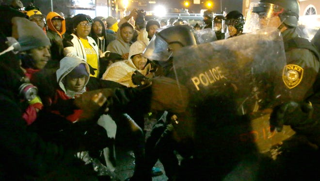 The father of a 24-year-old St. Louis woman says she lost an eye during a protest in Ferguson, Missouri, earlier this week when a police officer fired a beanbag at her boyfriend's car, shattering the windshield.