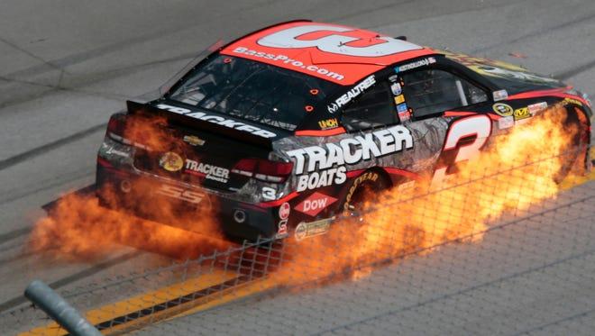 Austin Dillon's car catches fire during the Talladega 500 NASCAR Sprint Cup Series auto race at Talladega Superspeedway, Sunday in Talladega, Ala.