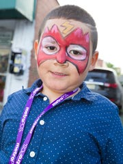 Noah Diaz (5) of Englewood sports a fresh face painting