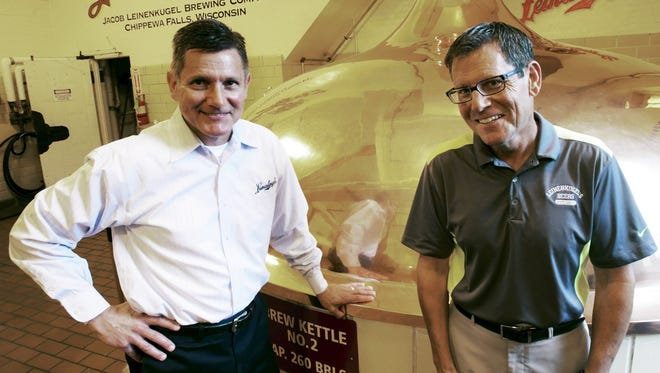 Dick Leinenkugel, left, and his brother Jake  Leinenkugel pose next to a brew kettle at the brewery in Chippewa Falls on Tuesday, Sept. 9, 2014.