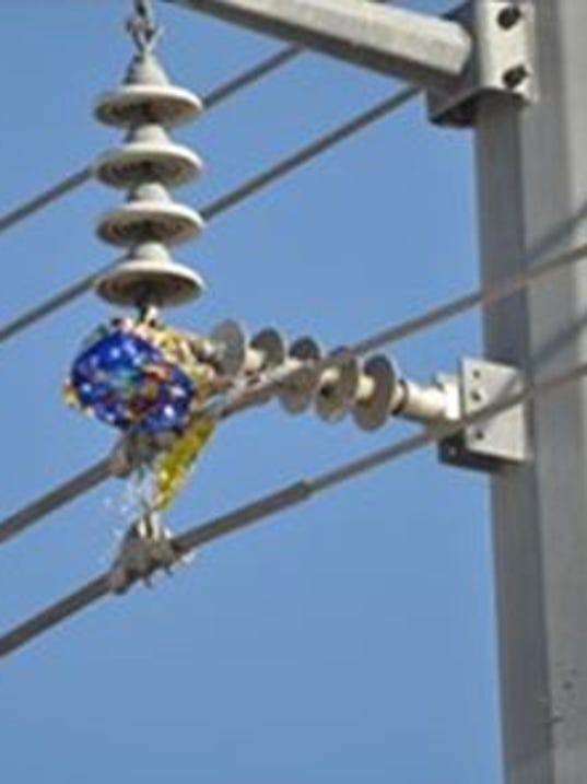 Mylar balloons into power lines