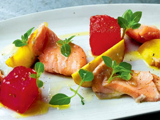 Cru, located at the Bell Tower Shops in south Fort Myers, features this summery dish of bronzed salmon with compressed watermelon and peaches.