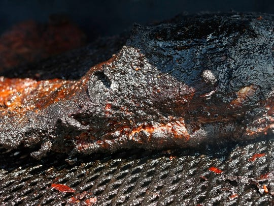 A 20 pound beef brisket has been in Chef Christie Burgess' 18-foot smoker during the Woodburn Firehouse Cookoff, at the Wooden Shoe Tulip Fields, on Saturday. Burgess was concerned that she might miss the event after her 18 smoker was stolen from her Northeast Salem home a few weeks ago.