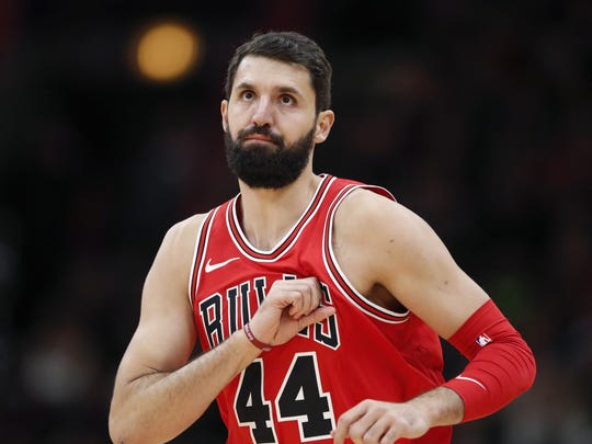 Chicago Bulls forward Nikola Mirotic reacts after scoring