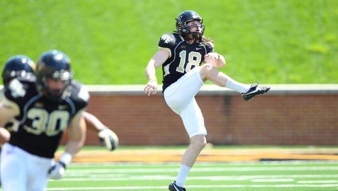 Southside High graduate Mike Weaver punts for Wake Forest during its Black vs. Gold spring football game April 26 at BB&T Field in Winston-Salem, N.C.