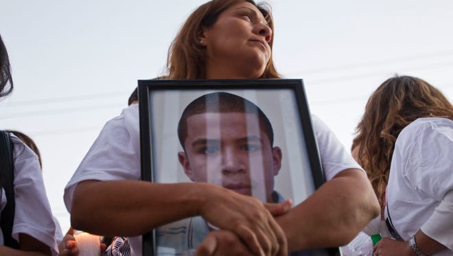 Araceli Rodríguez, mother of Jose Antonio Elena-Rodriguez, who was shot to death by the Border Patrol in 2012, marches along the border fence in Nogales with family, friends and human-rights groups protesting the Border Patrol's use-of-force policies.