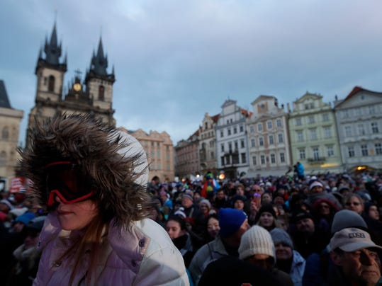 Young girl wearing goggles waits to welcome with two time gold winter olympic medalist Ester Ledecka at the Old Town Square in Prague, Czech Republic, Monday, Feb. 26, 2018. Ester Ledecka has received a hero's welcome in the Czech capital after winning an unprecedented double at the 2018 Winter Olympics in Pyeongchang, taking the gold medal in snowboarding's parallel giant slalom to pair with her shocking skiing victory in the Alpine super-G. (AP Photo/Petr David Josek)