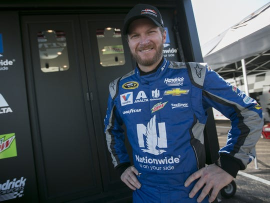 Dale Earnhardt Jr. stands in front of his trailer at