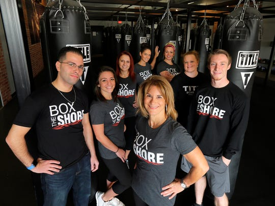 Ann Marie Earle, owner, poses with her staff at Title Boxing Club in Holmdel.