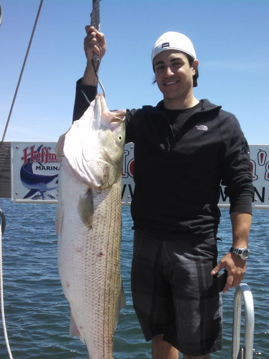 43.55lb striped bass. Michael Trezza first bass ever.jpg