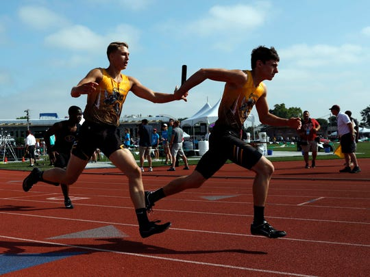 Northmor's Drew Zoll hands off the baton Adam Petulla  Saturday, June 2, 2018, as they run in the 800 meter relay Saturday, June 2, 2018, at Jesse Owens Memorial Stadium in Columbus.