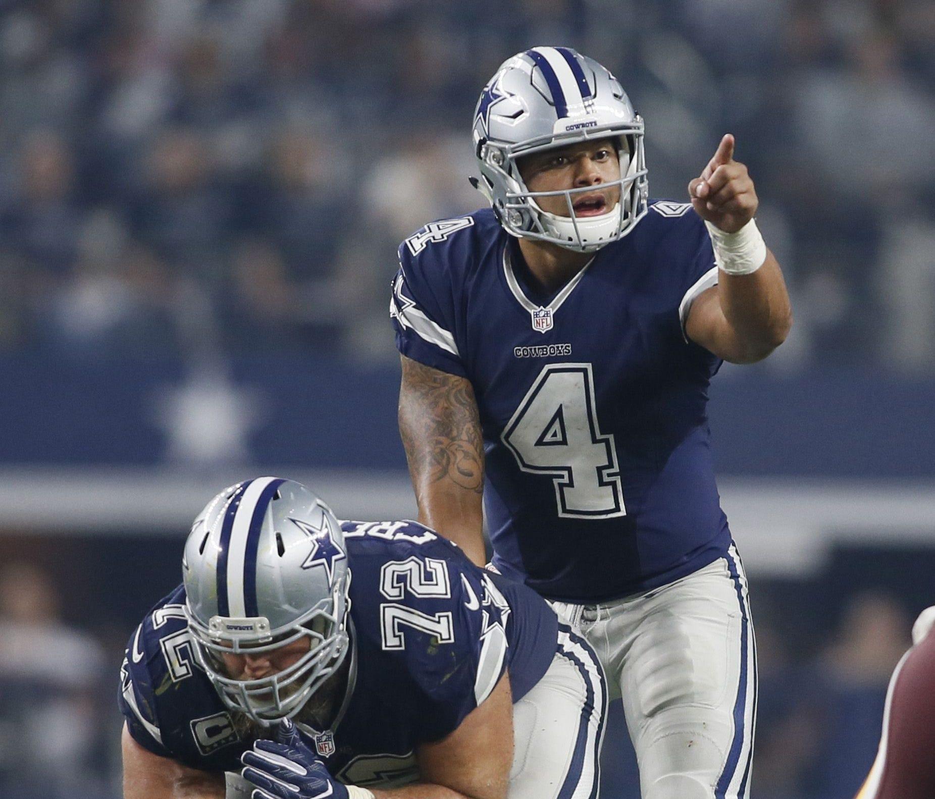 Dallas Cowboys quarterback Dak Prescott (4) calls a play in the fourth quarter against the Washington Redskins at AT&T Stadium.