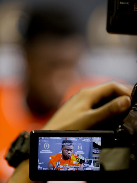Clemson defensive end Shaq Lawson in interviewed during media day for the NCAA College Football Playoff National Championship in Phoenix, Saturday, Jan. 9, 2016. Clemson will face Alabama in Monday's game. (AP Photo/David J. Phillip)