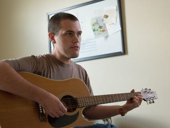 Tim Hretz, plays a Mumford and Sons song during his music lessons with Annie Pennies.