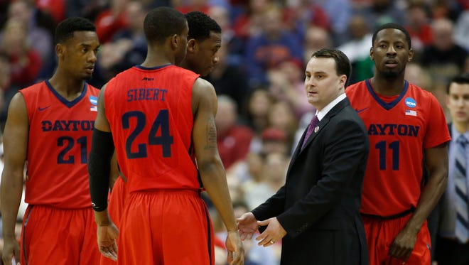 Dayton Flyers head coach Archie Miller speaks to his team during the first half against the Providence Friars in the second round of the 2015 NCAA Tournament at Nationwide Arena.