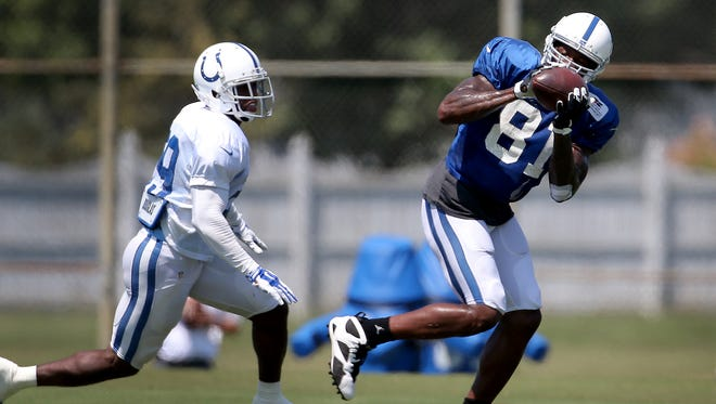 Indianapolis Colts wide receiver Andre Johnson (81) makes a catch next to defensive back Raymon Taylor (39)at the Colts training camp Thursday, August 13, 2015, afternoon at Anderson University in Anderson IN.