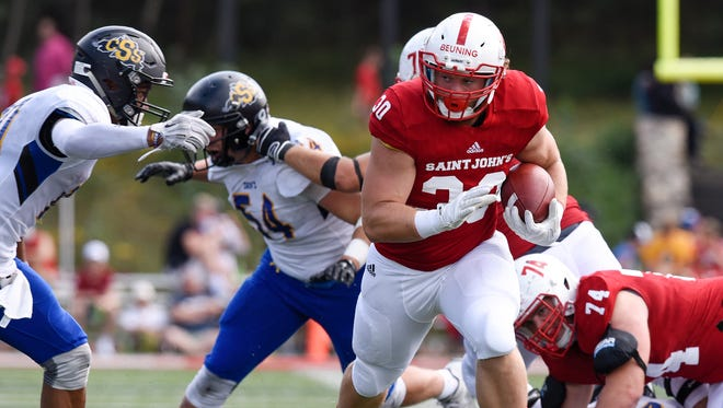 Ben Beuning carries the ball for St. John's during the Saturday, Sept. 3, game at Clemens Stadium in Collegeville.