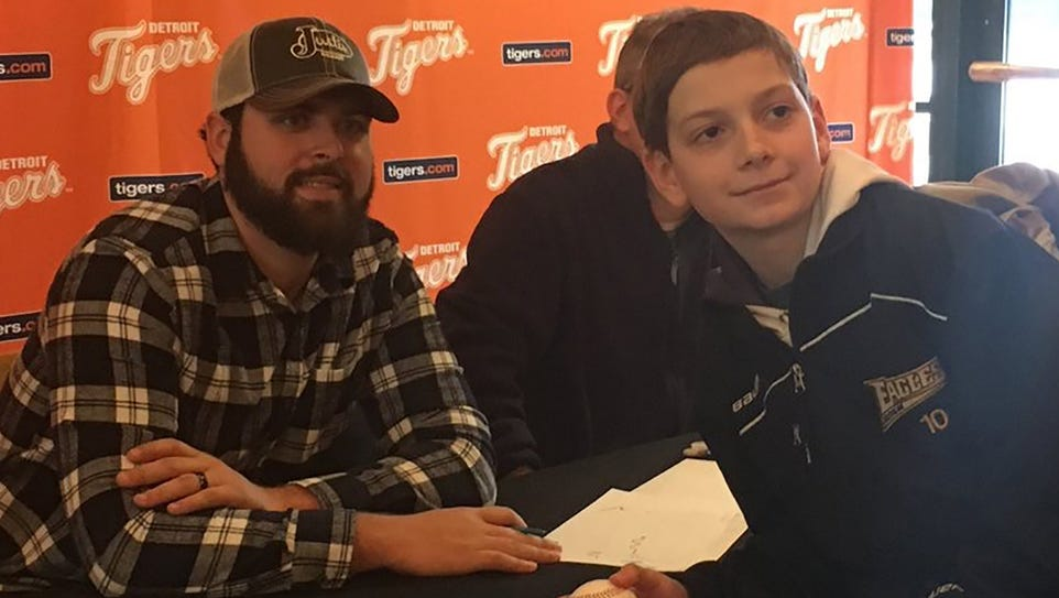 Tigers pitcher Michael Fulmer, left, poses for a photo