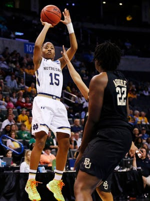Notre Dame guard Lindsay Allen (15) shoots over Baylor forward Sune Agbuke (22) during the second half of a regional final in the NCAA women's college basketball tournament, Sunday, March 29, 2015, in Oklahoma City. (AP Photo/Sue Ogrocki)