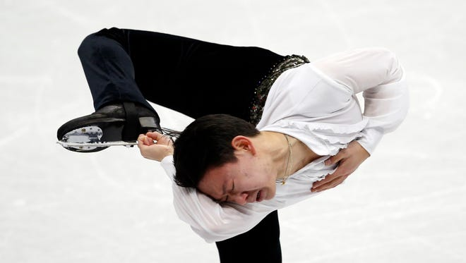Denis Ten of Kazakhstan performs during the men's short program at the ISU Four Continents Figure Skating Championships in Seoul Feb. 12.