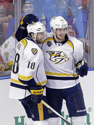 Predators left wing James Neal (18) is congratulated by teammate Ryan Johansen (92) after scoring in the second period Saturday.
