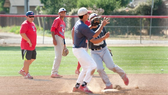 Tulare Western baseball coach Phil Correia, left, enters