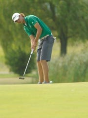 Jimmy Albright rolls a putt toward the hole on No.
