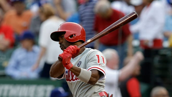 Philadelphia Phillies' Jimmy Rollins (11) follows through on a ground out to short off a pitch from Texas Rangers starting pitcher Martin Perez in the first inning of a baseball game, Tuesday, April 1, 2014, in Arlington, Texas. (AP Photo/Tony Gutierrez)