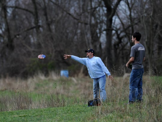 Jason Duchon, chairman of the Lancaster Disc Golf Alliance putts as he plays a round of disc golf Sunday, April 2, 2017, at the Flatrocks Disc Golf Course at Keller-Kirn Nature Park in Lancaster.