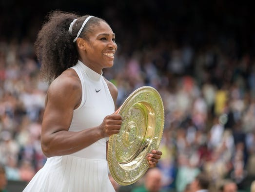 Serena Williams poses with the Wimbledon trophy after