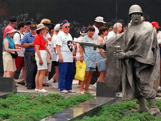 Visitors walk through the Korean War Veterans Memorial