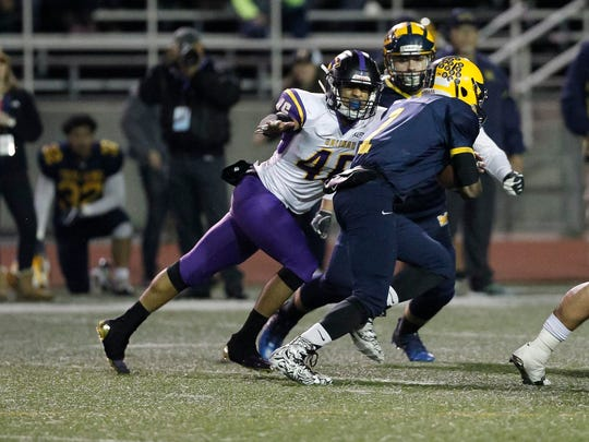 Salinas' Gustavo Montoro tackles Mipitas' Tyree Bracy during a Central Coast Section: Open Division I Championship football game between the Salinas Cowboys and the Milpitas Trojans at Independence High School on Friday, December 1, 2017 in San Jose, Calif. Vernon McKnight/for The Californian