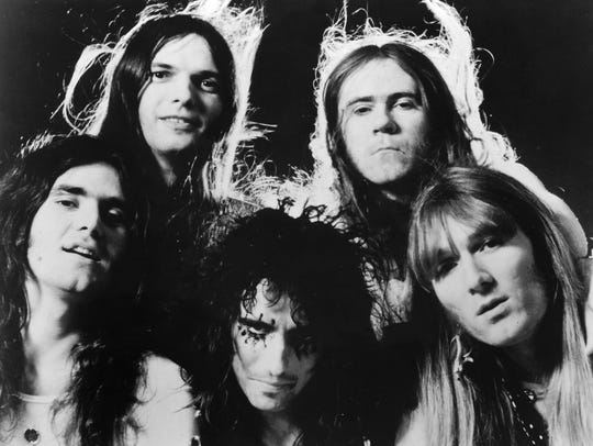 "The original Alice Cooper band, clockwise from bottom center: Alice Cooper, Michael Bruce, Dennis Dunaway, Glen Buxton and Neal Smith. Bruce, Dunaway and Smith joined Cooper on two songs on his latest album, ""Paranormal."" Buxton died in 1997."