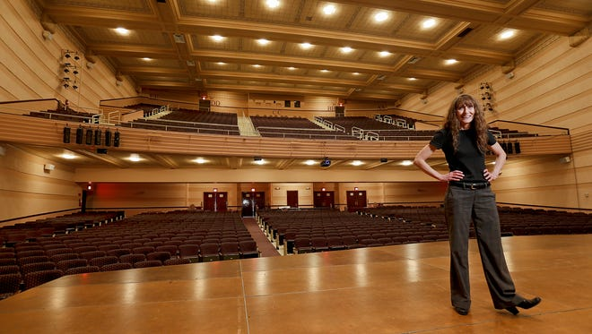 Dona Hughes, events supervisor for the Mansfield Theater, stands on the stage of the auditorium that can seat a maximum of 1,782 people. A new foundation, for which Hughes is a liaison, hopes to maximize the theater's use by helping smaller groups with rental fees.