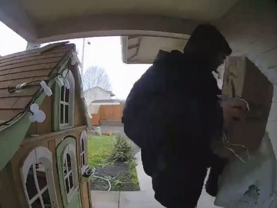 A package theft was caught on camera at a Keizer home