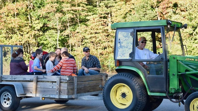 A hayride during a West Michigan festival in 2018. Local farms and orchards are currently preparing for this year's fall season.