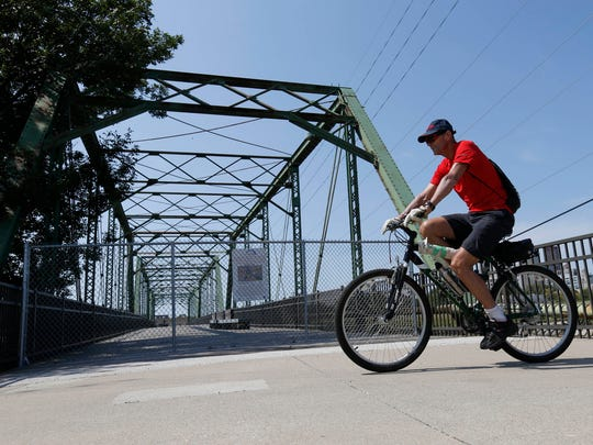 The 5th Street Bridge, a pedestrian bridge that spans the Raccoon River south of downtown Des Moines, reopens Friday morning.