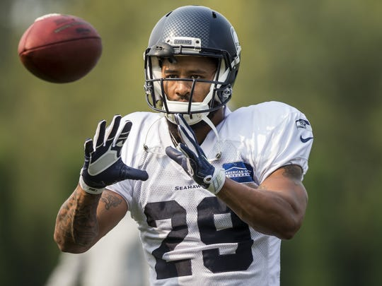 Seahawks free safety Earl Thomas does some throwing and catching with his fellow defensive players at the Seattle Seahawks Training Camp at the Virginia Mason Athletic Center in Renton, Wash., Sunday, Aug. 6, 2017. (Bettina Hansen/The Seattle Times via AP)