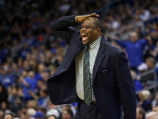 Georgetown Hoyas head coach Patrick Ewing signals against