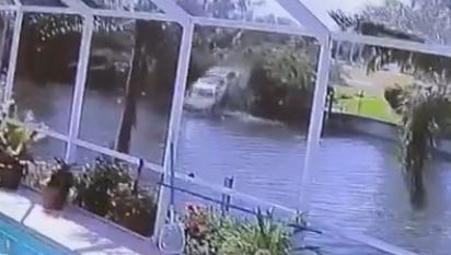 A Cape Coral driver plunged into a canal Monday  after a crash. The plunge was caught on a resident's security cam.