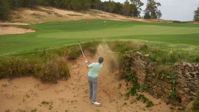 A golfer extricates his ball from a bunker on Mammoth Dunes at Sand Valley in Nekoosa.