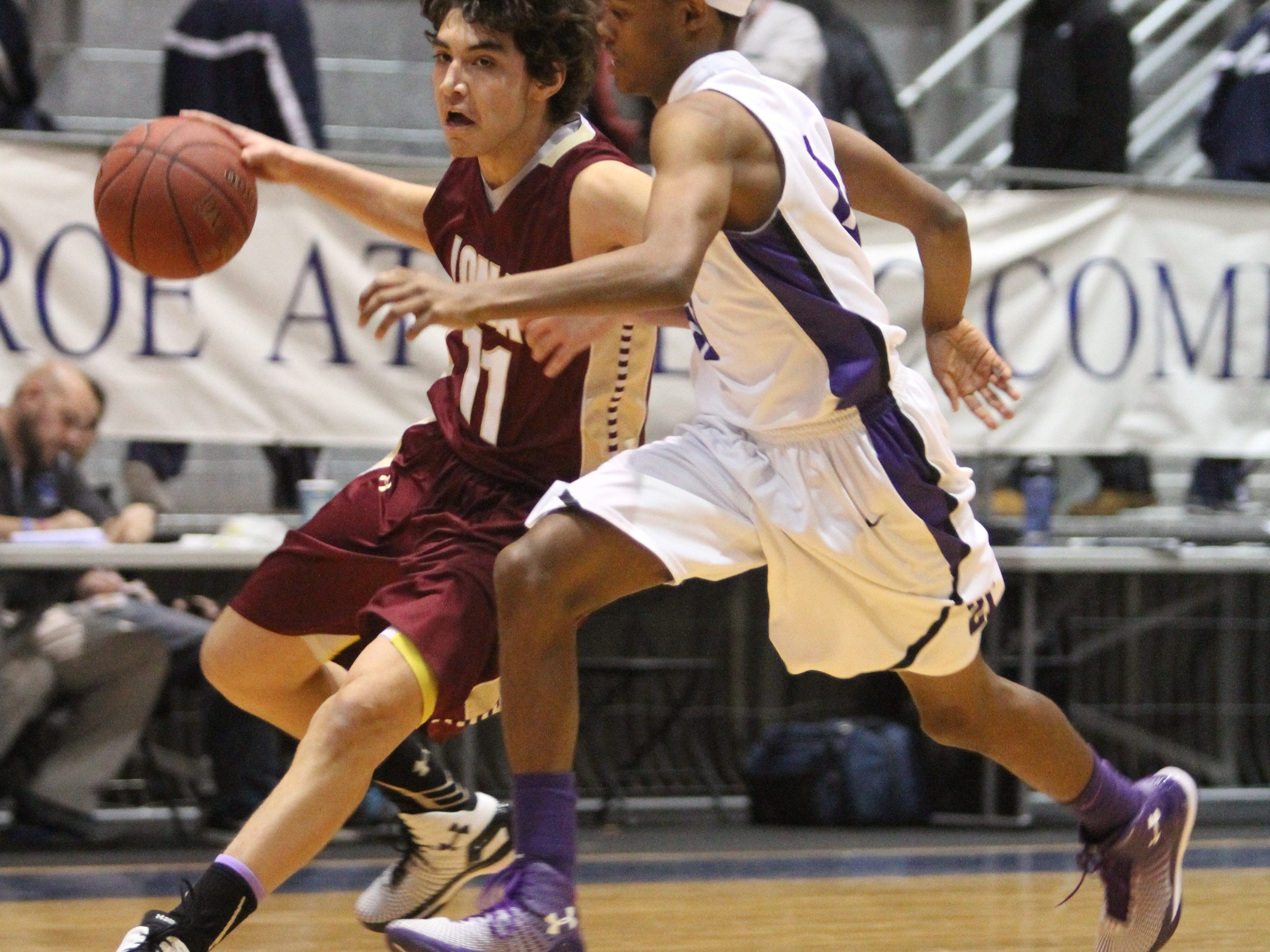 Mark Vergari/The Journal News Iona Prep's Ty Jerome drives past New Rochelle's Justin Watson during the Hoops for a Cure tournament Saturday. Iona Prep's Ty Jerome moves the ball around New Rochelle's Justin Watson during the 4th annual Hoops for a Cure basketball tournament at the Monroe Athletic Complex in New Rochelle, Jan. 10, 2015.