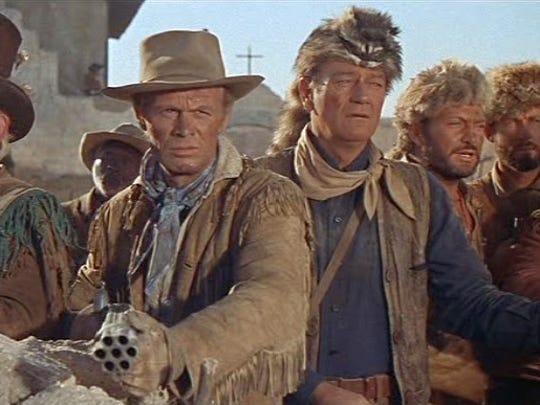 John Wayne (in coonskin cap) played Davy Crockett and