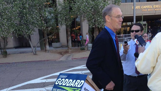 Terry Goddard hauled in boxes of petitions  to the Arizona Secretary of State's Office on April 28, 2014.