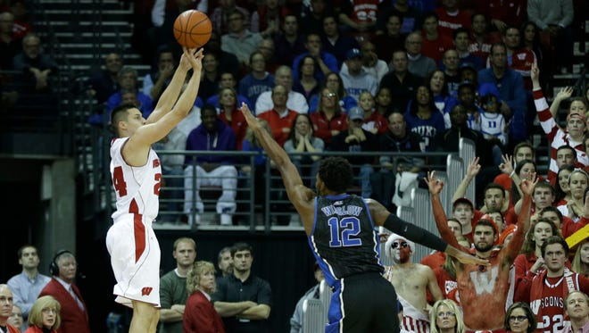 MADISON, WI - DECEMBER 03: Bronson Koenig #24 of the Wisconsin Badgers shooter a three pointer during the first half against the Duke Blue Devils at Kohl Center on December 03, 2014 in Madison, Wisconsin. (Photo by Mike McGinnis/Getty Images)