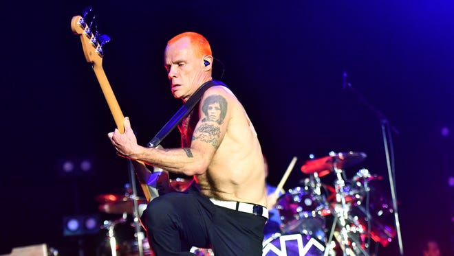 Red Hot Chili Peppers bassist Flea, seen here performing with the band in January, took a break from touring last weekend to get married to designer Melody Ehsani.