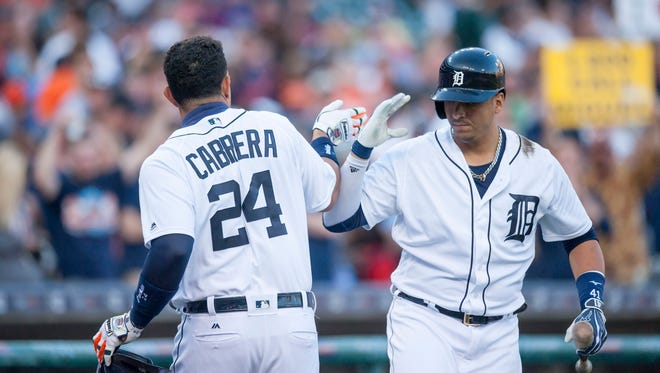Detroit first baseman Miguel Cabrera, left, gets a high-five from designated hitter Victor Martinez after Cabrera hit a home run in the third inning.